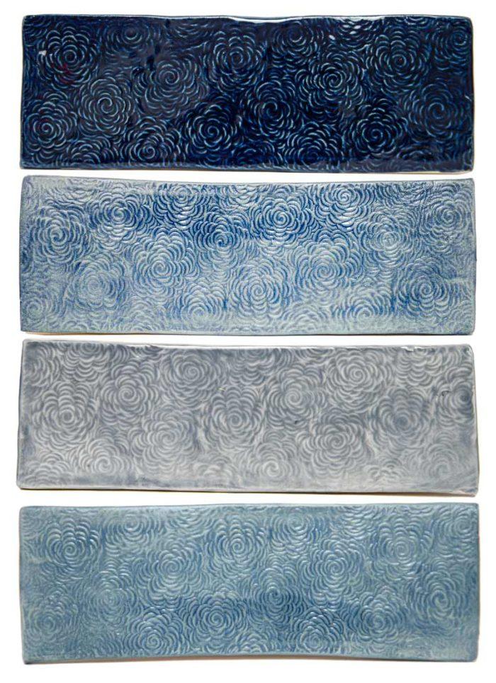 Navy blue glaze on handmade floral textured bathroom tiles shades