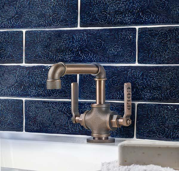 Navy blue glaze on handmade floral textured bathroom tiles