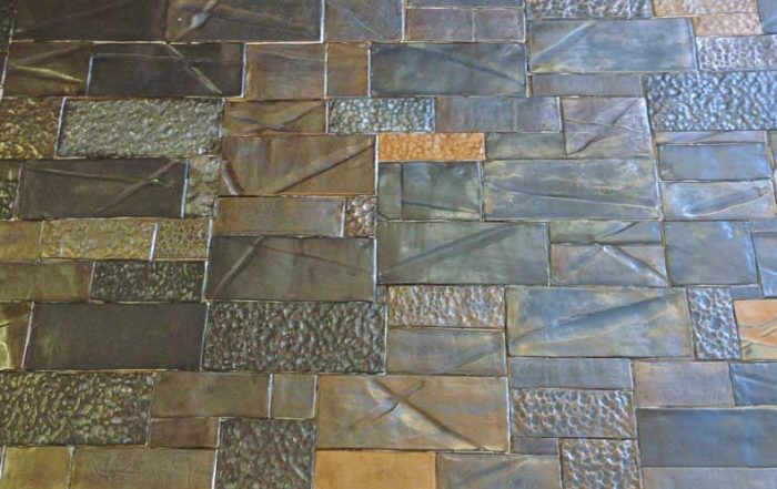 Handmade ceramic tiles with Metal glazes and mixtures of textured surfaces