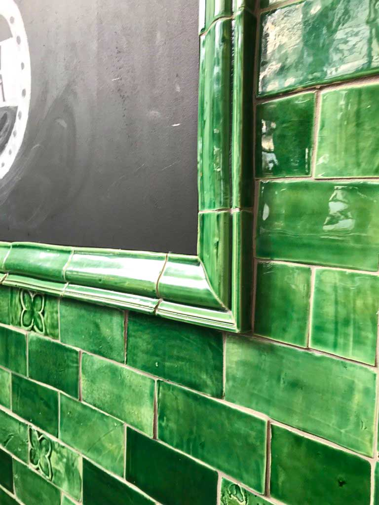 The architectural moulding of these green tiles makes for a perfect finish