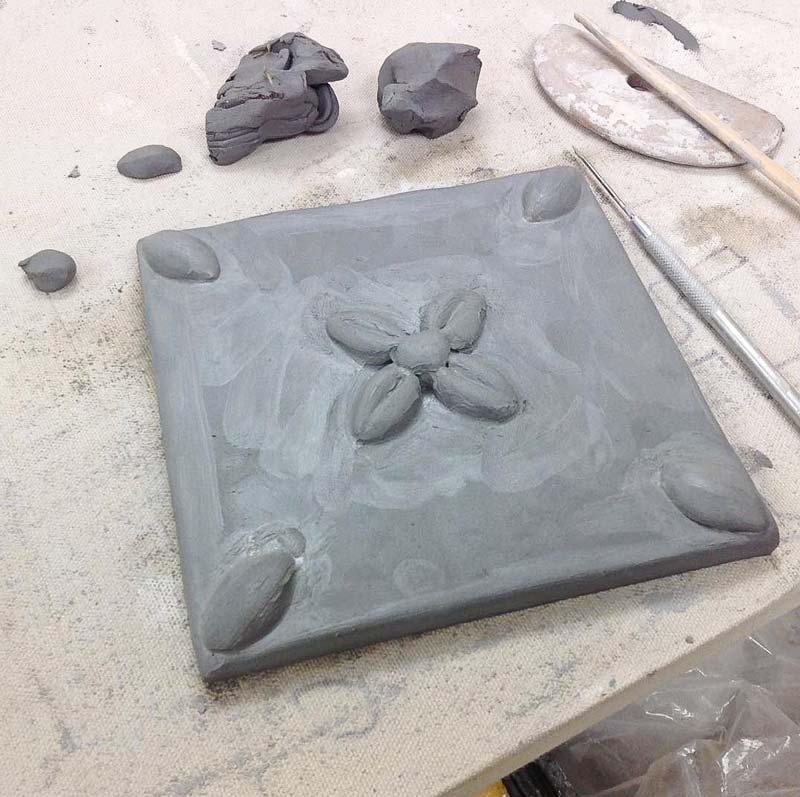 Wet pressed tile