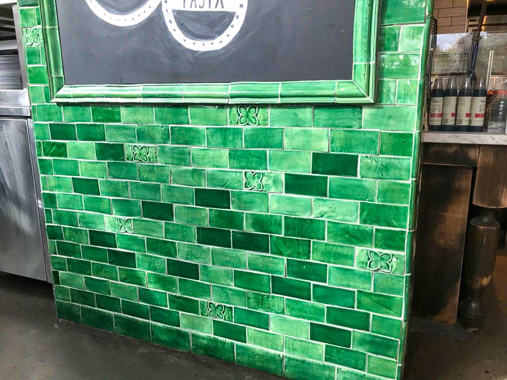 emerald green glaze tile accent wall