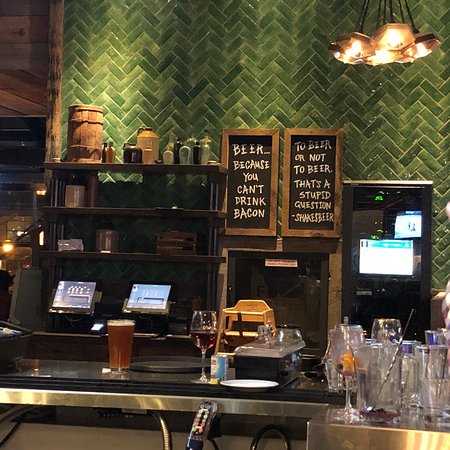 The green tiles are a focal point in the Goodman Pub & Kitchen